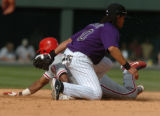 (DENVER COLO.,  MAY 17, 2004)  Rockies shortstop Royce Clayton puts a tag on Phillies  Jimmy...