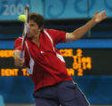 (Athens, Greece  on Thursday, Aug. 19, 2004) - American tennis player Taylor Dent returns the...