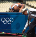 (Athens, Greece  on Friday, Aug. 20, 2004) -As an official pick up the high jump bar distrubed by...