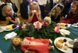 MJM073   Triplets, Shelby Zimmerman,6, left to right, Madison Zimmerman and Abigail Zimmerman, sit...