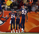 In the third quarter, the Denver Broncos Champ Bailey (#24, CB) celebrates his interception with...