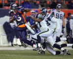 In the fourth quarter, the Denver Broncos Brandon Marshall (#15, WR) breaks the tackles of the...