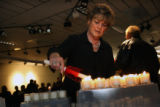 MJM034   Joan Palmer (cq), of Colorado Springs, lights a candle for her son, Billy Palmer during...