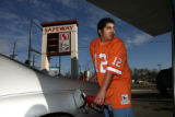 Ronnie Roybal (cq), of Denver, fills-up his car with gas at a Safeway gas station Monday afternoon...