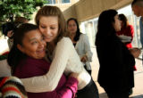 MJM334  Alicia Figueroa, left, is hugged by her daughter, Blanca Figueroa, 21, left center, after...