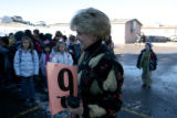 Creekside Elementary School principle Diane Bernero, cq, monitors students as they line up for...