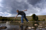 (Summit County, Colo., September 3, 2004) Bryan Gardner, 10, of Silverthorne, balances on a rock...