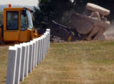 (DENVER, Colo., August 16, 2004) A heavy equipment vehicle piles rocks in the expansion area...