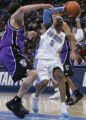 Denver Nuggets guard Allen Iverson, right, is tightly guarded by Sacramento Kings defender Mike...