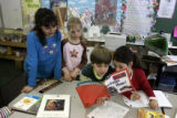 Jack Koskinen, 8, second from right,, reads a book with other Cory Elementary second-graders...