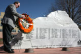 Colorado Department of Transportation Executive Director Russell Georg, cq, places a wreath on the...