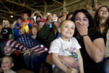 DLM3941  Melissa Gossett breaks into tears as she and her son Kaenon, 3, watch as Sgt. Steven...