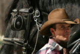 MJM292 Jim Pavlich (cq) of M Lazy C Ranch in Lake George, Colo. stands by a pair of Percheron...