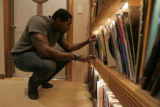 Trevor Pryce searches through his record collection at his home and studio in Lone Tree Colo.,...