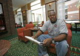 Former Denver Broncos player Tony Jones in the lobby of his hotel in downtown Birmingham, AL,...