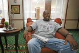 Former Denver Bronco player Tony Jones in the lobby of his hotel in downtown Birmingham, AL,...