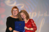 Honoree and Rocky Mountain News On the Town columnist Penny Parker, left,  accepts the Courage...