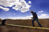 Victor, Colo., photo taken May 10, 2004-T.J. Walker (right) and co-worker Will Adams (left) lay...