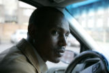 Daniel Negash (cq) a Denver area taxi driver, sits outside of  Denver apartment complex waiting...