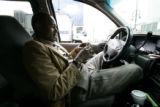 Daniel Negash (cq) a Denver area taxi driver, sits outside of the Denver Convention Center in...