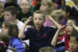 Garrison Hayes (cq), a young cancer survivor, reacts upon hearing his name, as he was honored with...
