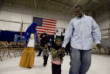 DLM0211  Rusulo Rusulo walks back to his seat with his four-year-old daughter Asha Mahamud as his...
