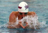 Mark Dylla, of Heritage High School, does the breast stroke during the 200 yard individual medley,...