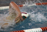 Mark Dylla, of Heritage High School, does the freestyle stroke, during the 200 yard individual...