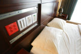 The hospital equipment is hidden behind sliding panels on the headboard in the bedroom of the...