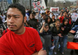 (from left) Metro State University, Auraria Campus student Enrique Castillo (cq) joins in an...