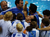 (Athens, Greece  on Sunday, Aug. 15, 2004) - Greek synchronized diver Thomas Bimis is mobbed by...