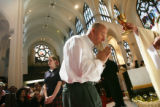 MJM250 Gary Kummer of Littleton, Colorado takes communion during  the Chrism Mass Tuesday 04/03/07...