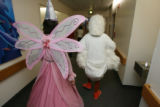 The princess and the duck head down a hallway to waiting children in their rooms. The Easter...