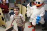 Becky Adams, (cq), background, encourages her son Benjamin to dance with the duck in his room. He...