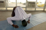 (DENVER, Colo., August 30, 2004) Abduhl Hajy, Somalia, and a muslim, prays 5 times a day. On site...