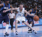 Denver Nuggets guard Steve Blake, right, drives to the basket being defended by Dallas Mavericks...