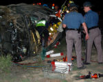 Colorado State Patrol Troopers examine the front of the SUV who struck another car at a clocked...