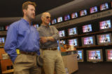 (Parker, Colo., September 1, 2004) Home Electronics Specialist Steve Becker, left, and customer...