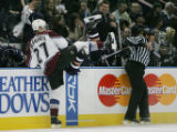 ***DIGITAL IMAGE*** Edmonton, AB :  MAR 23/07:   Linesman Jay Sharrers (right) leans out of the...