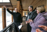 Robert and Lorie O'Neill, right, from Tennessee, stand on the balcony of their new HGTV Dream Home...