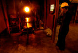 Victor, Colo., photo taken May 10, 2004-Molten gold is heated and poured into molds to make gold...