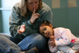 Lara Jean O' Conner, cq, sings along with her daughter Annagrace O' Conner, 2, of Golden during...