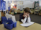 Sam Koskinen, 5, daydreams during his kindergarten class at Cory Elementary School.  His mother,...