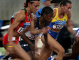 (ATHENS, GREECE-AUGUST 20, 2004) United States sprinter,Lauryn Williams, center, pulls past...