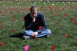 Joel Portman, (cq) sits for a portrait in the field of colored flags representing the 11 million...