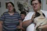Emotionally overwhelmed, left to right, Stephanie Monfelt cries as their son Jerry Montfelt,10,...