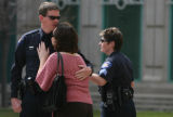 Aurora Police Department officer Keith Burke, cq hugs his wife Kristen Burke, cq, Monday Mar. 26,...