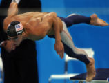 (Athens, Greece  on Monday, Aug. 16, 2004) - U.S. swimmer Michael Phelps dives into the pool to...