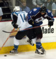 (DENVER, CO - 4/26/04) -- Colorado Avalanche defenseman Rob Blake, right, throws his hip into San...