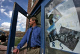 DLM0920  Rifle High School principal Todd Ellis stands at the front door of the school next to a...